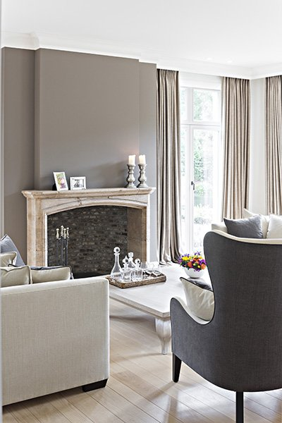 Klassieke woonkamer ontworpen door b+villas