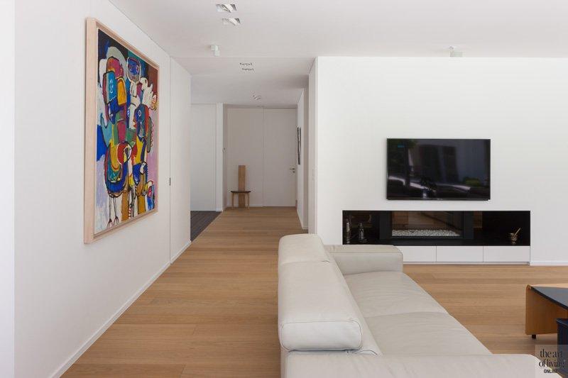 Woonkamer, living, outen vloer, doorkijkhaard, open haard, AMA haarden, zelfvoorzienende villa, Anja Vissers