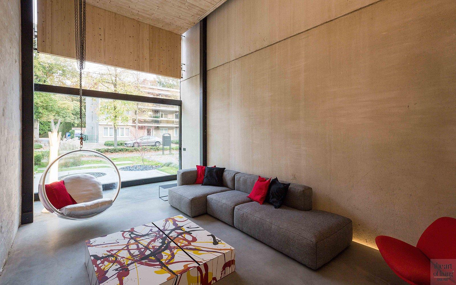 Icoon Architecten, woonkamer, bank, schommelstoel, ramen, open ruimten