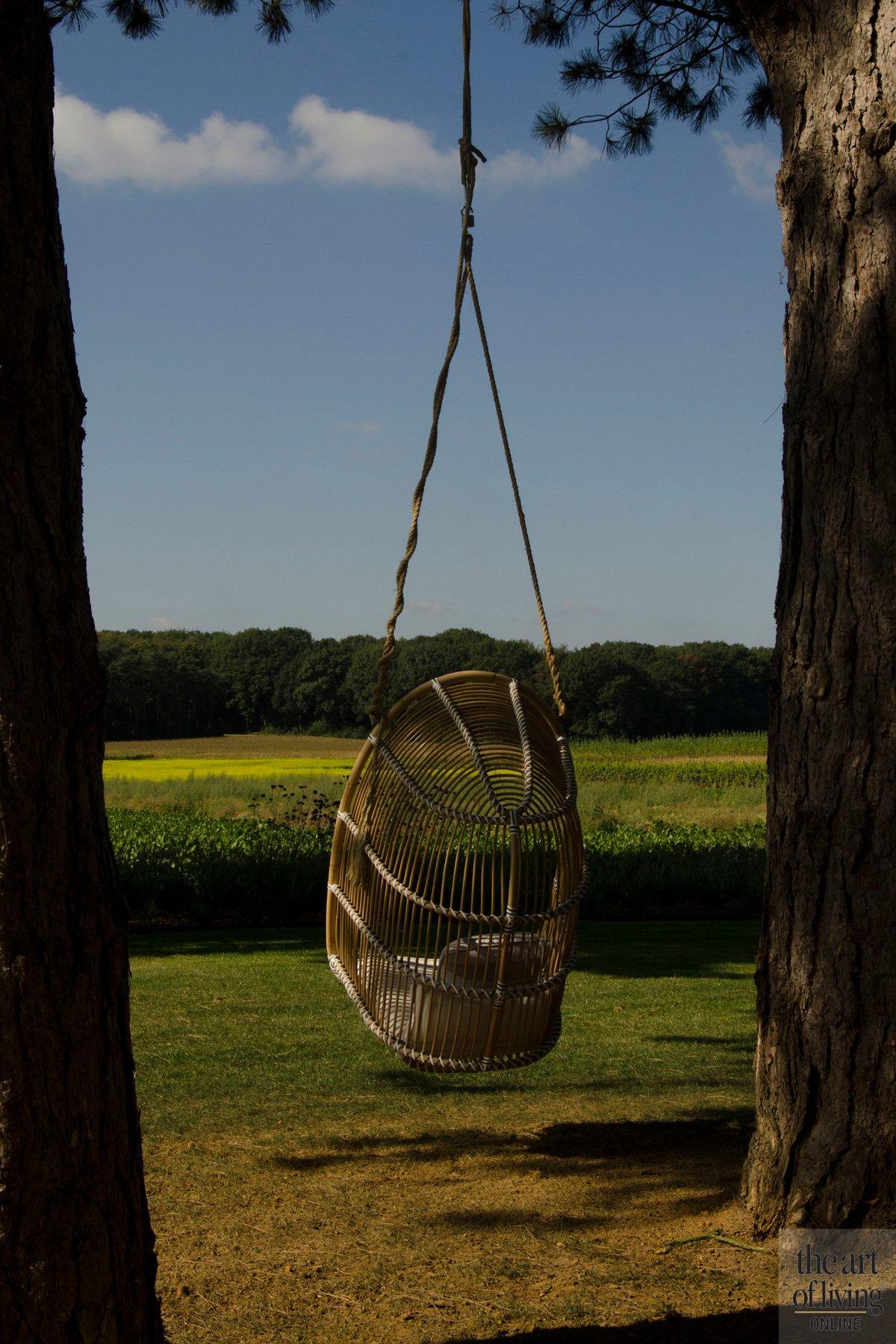 Schommelstoel, weids uitzicht, genieten, landschap, discrete tuin, Frederiek Snaet