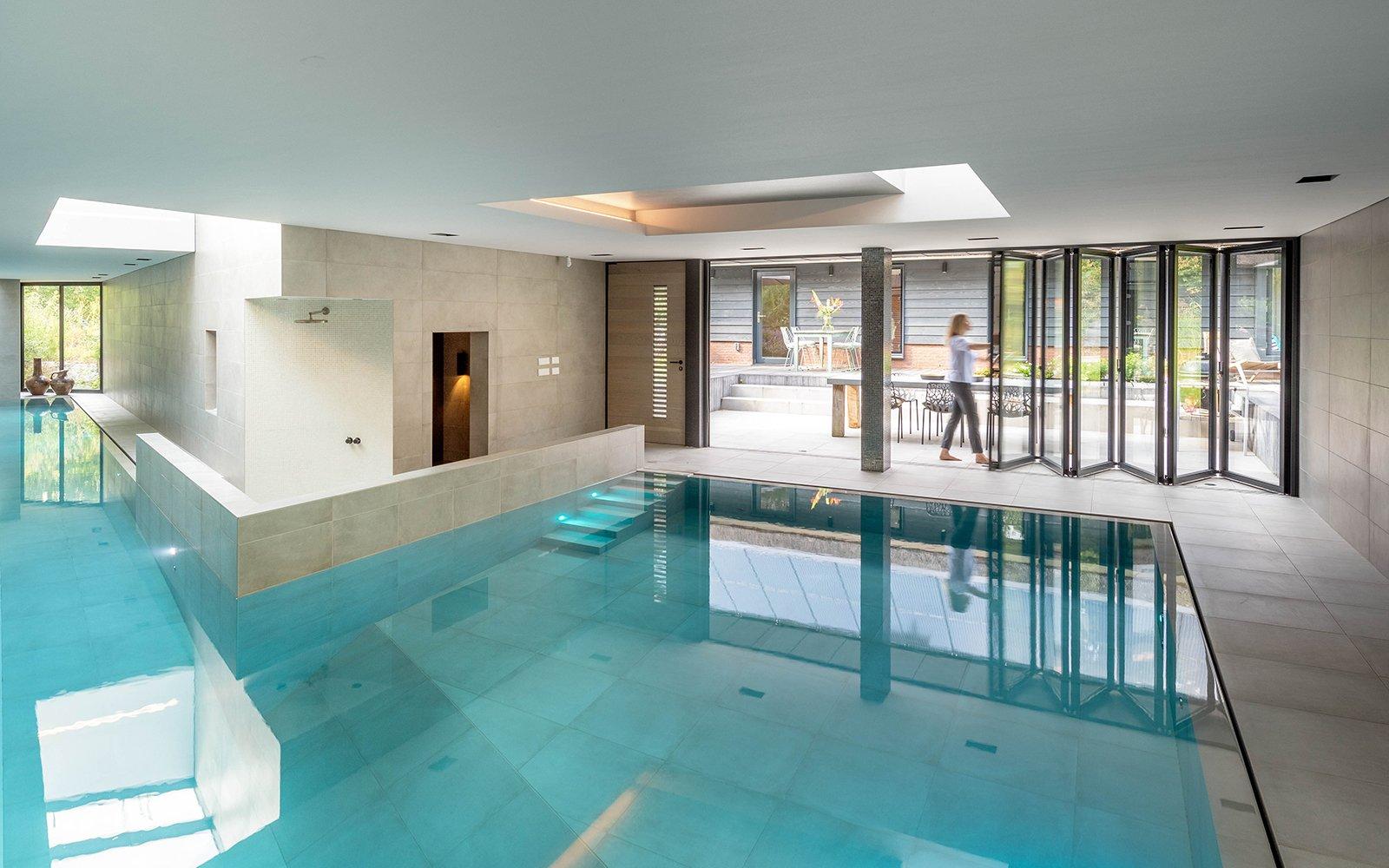 Harmonica glazen vouwwand, Solarlux, ondergronds binnenzwembad
