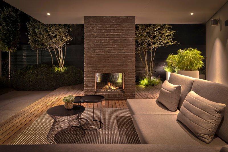 Design tuin, Knops tuindesign, zwembad, overdekt terras, openhaard, warme tinten, exclusief